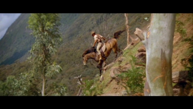 """But the man from Snowy River let the pony have his head, And he swung his stockwhip round and gave a cheer, And he raced him down the mountain like a torrent down its bed, While the others stood and watched in very fear."" Extract, The Man From Snowy River by Banjo Patterson (Image from the 1982 film of the same name)"