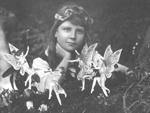 "In the manner of the Daily Mail: 'What the dog might have seen'* *Fine, it's Frances Griffiths and the Dancing Fairies, one of the photographs she and her cousin, Elsie Wright, took of ""real"" fairies, courtesty of http://www.cottingley.net/"